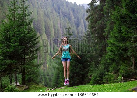 Free woman praising freedom in the forest