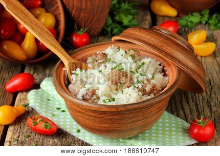 Basmati rice meat balls pilaf on wooden table