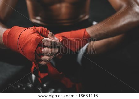 Partial View Of Muay Thai Fighter Swathign Hand In Boxing Bandage