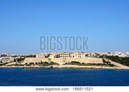 View of Manoel Fort on Manoel Island seen from Valletta with Sleima to the rear Valletta Malta Europe.