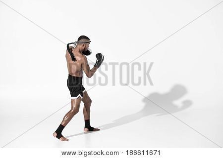 Side View Of Muay Thai Fighter Training Isolated On White, Fight Club Concept