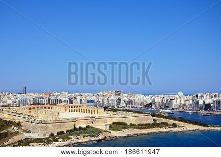 VALLETTA, MALTA - MARCH 30, 2017 - Elevated view of Manoel Fort on Manoel Island seen from Valletta with Sleima to the rear Valletta Malta Europe, March 30, 2017.