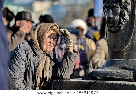 Yekaterinburg, Russia - 4 November, 2016: Old woman looks at the demonstration on the day of National Unity of Russia. Remembers demonstration November 7 in the USSR.