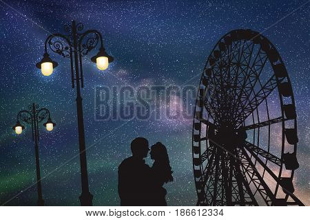 Lovers in amusement park at night. Vector illustration with silhouette of loving couple under starry sky. Vintage lampposts and Ferris wheel
