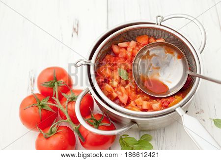 Cooking Tomatoes On A White Background