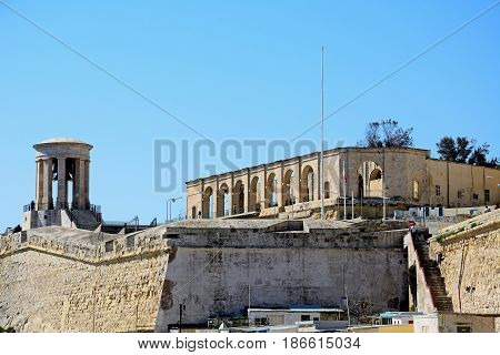 VALLETTA, MALTA - MARCH 30, 2017 - View of the Siege Memorial bell tower and Lower Barrakka Gardens arches Valletta Malta Europe, March 30, 2017.