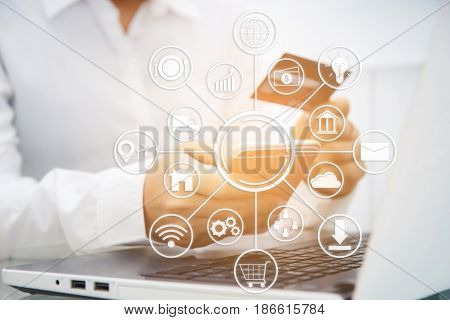 Business man or woman use smart-phone and holding credit card for pay money by online shopping website with laptop computer. technology. online payment. social. business icons.