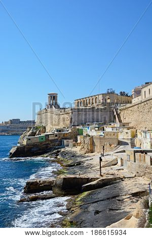 VALLETTA, MALTA - MARCH 30, 2017 - View along the waterfront towards the Siege Memorial bell tower and Lower Barrakka Gardens arches Valletta Malta Europe, March 30, 2017.