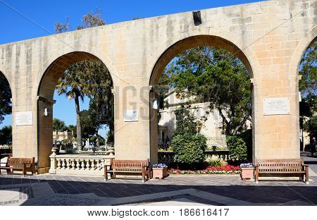 VALLETTA, MALTA - MARCH 30, 2017 - View of the Stock Exchange in Upper Barrakka gardens seen through the Saluting Battery arches Valletta Malta Europe, March 30, 2017.