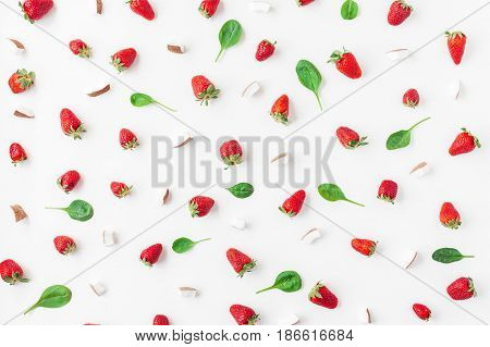 Fresh strawberry and coconut on white background. Fruit pattern. Summer concept. Flat lay top view