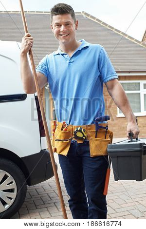 Portrait Of Plumber With Van Outside House