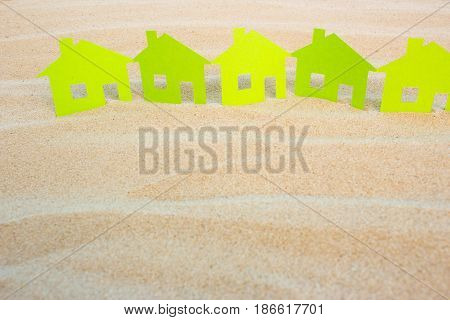 House in the sand by the sea. Rent or buy a cottage by the sea. Empty place for text copy paste