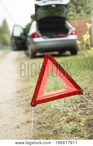 Broken down car. A broken car on the side. Warning triangle