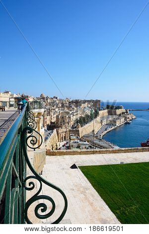 VALLETTA, MALTA - MARCH 30, 2017 - Elevated view of waterfront buildings seen from Upper Barrakka Gardens Valletta Malta Europe, March 30, 2017.