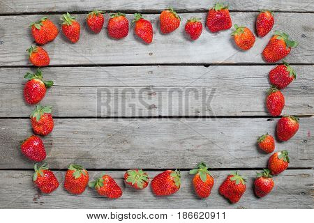 Frame Of Fresh Red Strawberries On Wooden Tabletop With Copy Space, Berries Background Concept