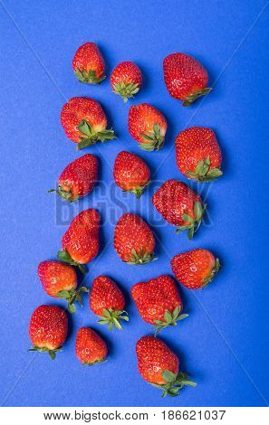 Top View Of Heap Of Fresh Red Strawberries Isolated On Blue, Berries Top View Concept