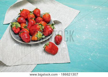 Fresh Red Strawberries With Powdered Sugar On Ceramic Gray Plate On Wooden Tabletop