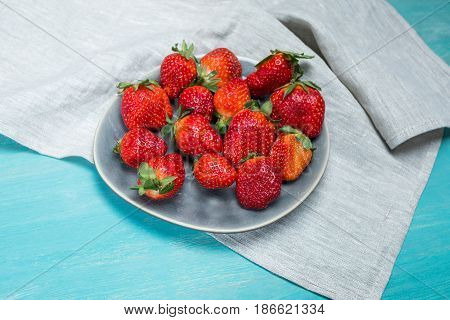 Fresh Red Strawberries On Ceramic Gray Plate On Wooden Tabletop