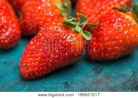 Close Up View Of Whole Ripe Red Strawberries On Tabletop