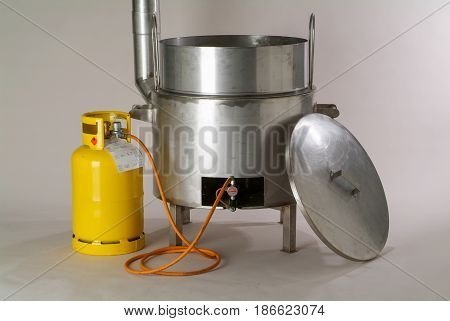 Rivera, Switzerland - 2 April 2009: Industrial gas pot to cook food and boil