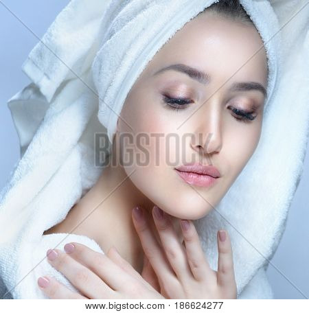 closeup beauty portrait of attractive young caucasian woman brunette on blue background studio shot lips