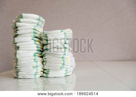 Diapers. Isolated. Baby Care. Studio Shot. Stacks Of Diapers For Children Isolated On White Backgrou