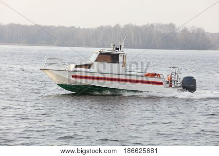 rescuer boat sails on Moscow river