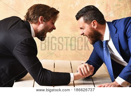 Arm Wrestling Of Businessman And Aggressively Compete Man