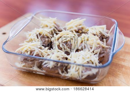 Stuffed mushrooms champignons with cheese cooked in the oven