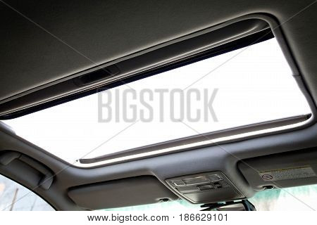 open automotive sunroof close up. interior. abstract