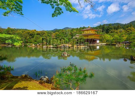 Kinkaku-ji, Golden Pavilion, famous buddhist temple zen of Rinzai sect in Kyoto reflected in the lake. The Rokuonji is one of most visited Kyoto temples. Concept of Buddhism and meditation.
