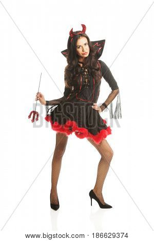 Sexy woman wearing devil clothes, standin astride, holding trident