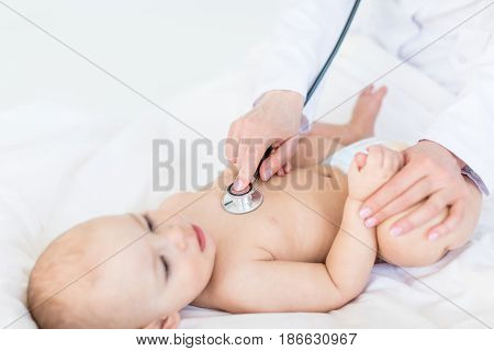 Cropped Shot Of Medical Worker Examining Baby Boy With Stethoscope, 1 Year Old Baby Concept