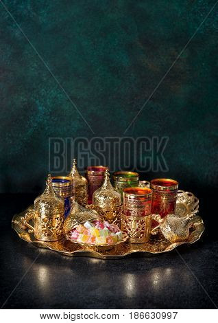 Tea table golden decoration. Oriental hospitality. Ramadan kareem. Eid Mubarak