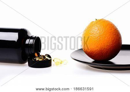 Fish Oil With Vitamin In Black Plastic Jar And Orange Fruit