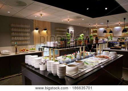 OSLO, NORWAY - JAN 21st, 2017: airport business class lounge interior of SAS, buffet and eating area in a frequent flyer lounge for SAS Gold customers, food and drinks.