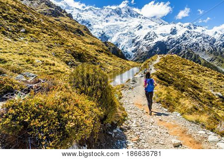 New zealand hiking girl hiker on Mt Cook Sealy Tarns trail in the southern alps, south island. Travel adventure lifestyle tourist woman walking alone on Mueller Hut route in the mountains.