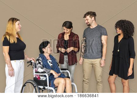 Group of Diverse People Talking with Handicap Woman Studio Portrait