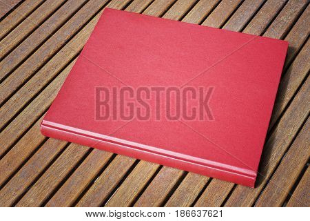Red book on the outdoor wooden table at coffee shop