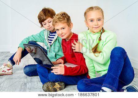 Three children friends spending time together. Friendship. Children's fashion.
