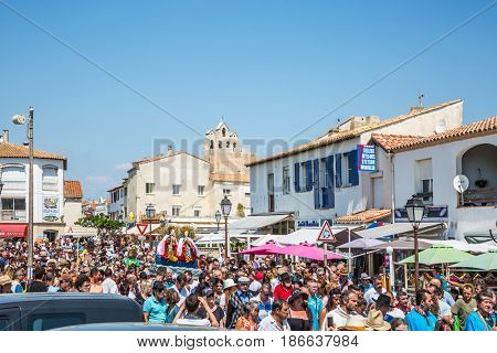 Saintes-Maries-de-la-Mer, France - May 25, 2015. Religious feast in honor of the Holy Maries in Provence. The crowd is accompanied by two statues Holy Maries. The concept of ethnographic tourism