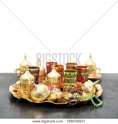 Ramadan kareem. Holidays decoration. Arabic tea coffee service with golden cups. Oriental hospitality concept