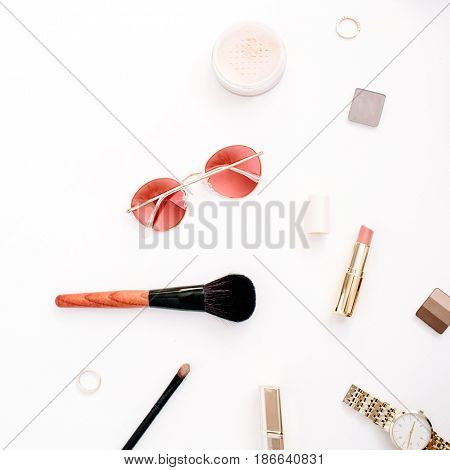 Beauty blog fashion concept. Female pink styled accessories: watches sunglasses cosmetics on white background. Flat lay top view trendy feminine background.