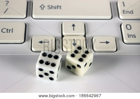 Dice on computer keyboard. Concept business risk chance luck or gambling.