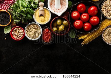 Food background Food Concept with Various Tasty Fresh Ingredients for Cooking. Italian Food Ingredients. View from Above with Copy Space.