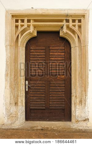 detailed entrance of old church with sculpted stone surround