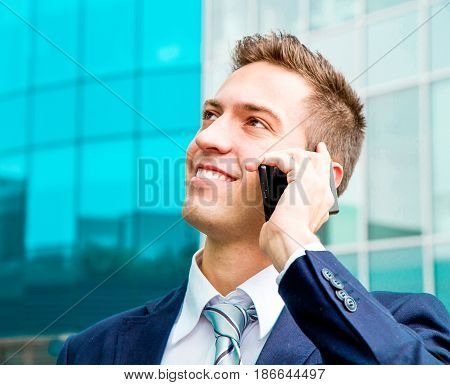 a Portrait of a young businessman talking on the phone