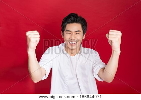 Cheerful Elegant Young Handsome Asian Man Over Red Background. Cool Fashion Male Model.