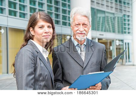 a Businessman And Businesswoman discussing a project