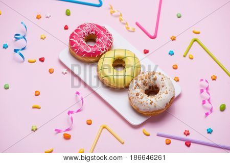 Party. Different Colourful Sugary Round Glazed Donuts And Bottles Of Drinks On Pink Background.